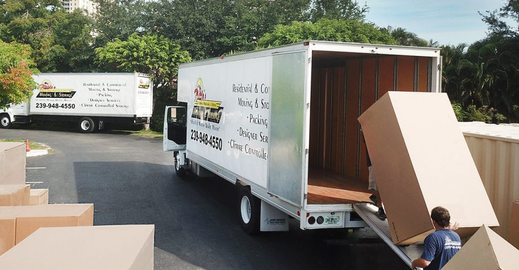 Loading packaged items into moving truck